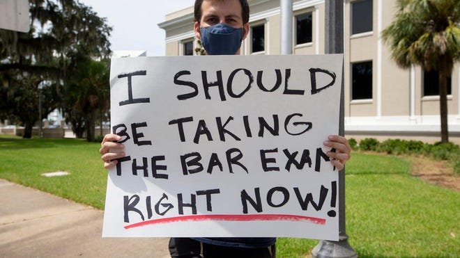 Michael Ellis, a former Florida International University Law School student, organized a protest of the postponement of the Florida Bar Exam at the Florida Supreme Court Wednesday, August 19, 2020.