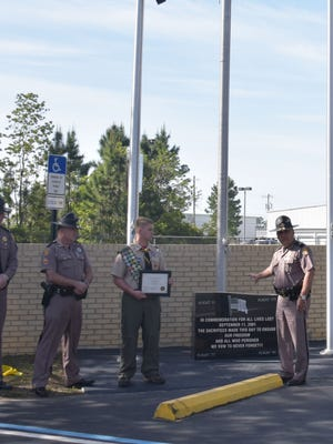 Florida Highway Patrol officials recognize and thank Eagle Scout Wyatt Moore for installing a 9/11 memorial on site at the agency's Pensacola site.