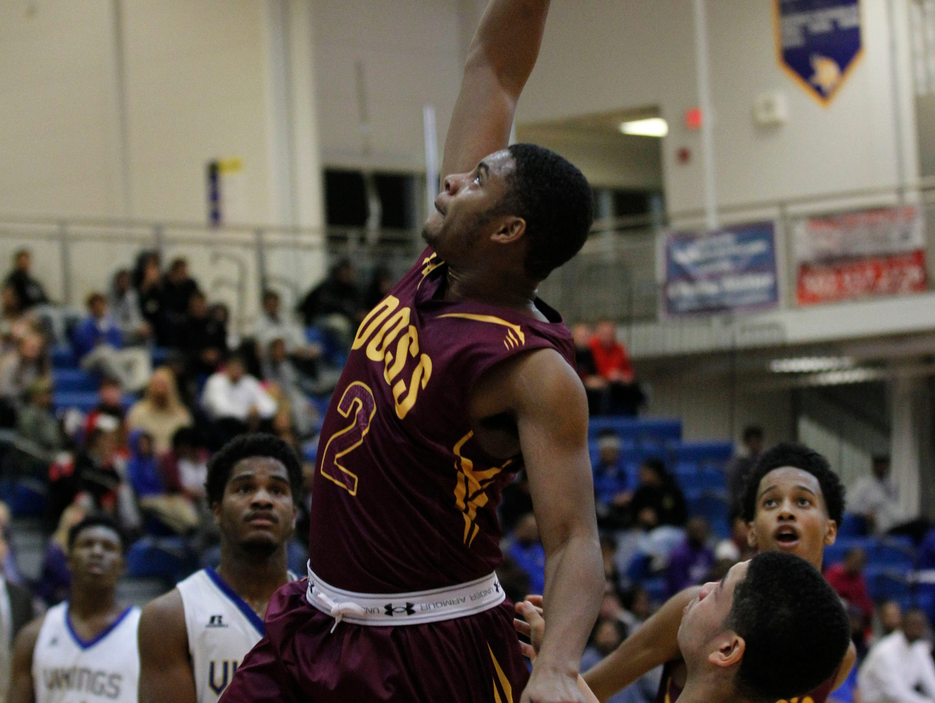 Doss High School's Stephon Franklin (2) fights to get his shot off under pressure from Valley High School's Tre Anderson (23) during the first half of play at Valley High School in Louisville, Kentucky. January 3, 2017