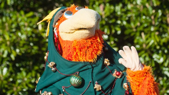 Sherman the Shorebird waves to his devoted fans at