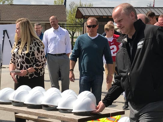 School officials, sponsors and students take hard hats