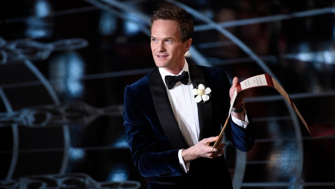 Neil Patrick Harris reads his picks at the 87th annual Academy Awards at the Dolby Theatre.