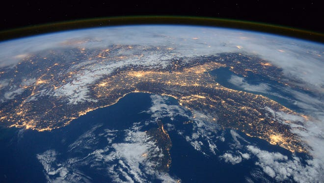 """Expedition 46 flight engineer Tim Peake of the European Space Agency (ESA) shared this nighttime photograph with his social media followers on Jan. 25, 2016, writing, """"Beautiful night pass over Italy, Alps and Mediterranean."""""""
