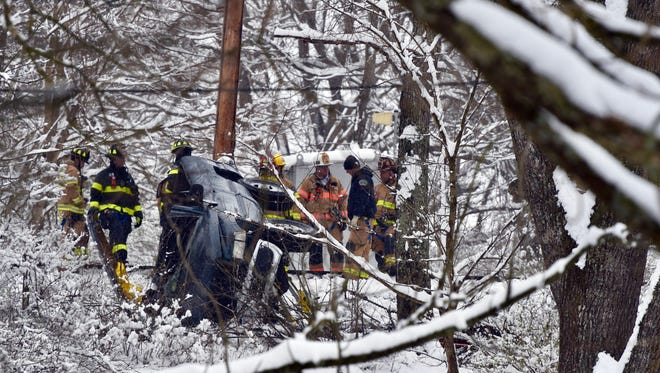 Crews deal with the scene of a Staunton vehicle accident after it was struck by a train Monday in Staunton.