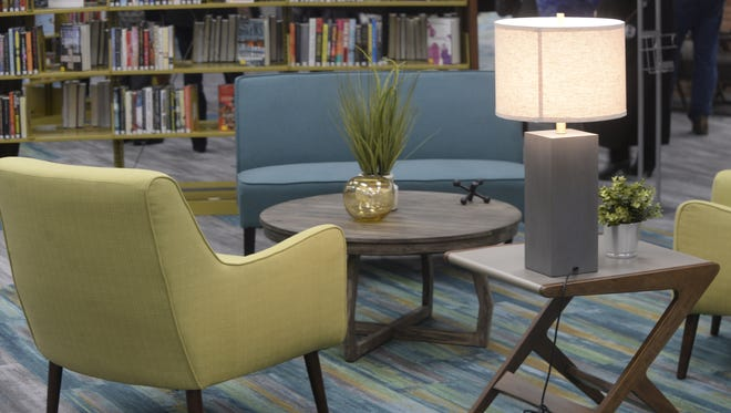 Colorful chairs with tables, plants, lamps and knickknacks are placed throughout Morrisson-Reeves Library.