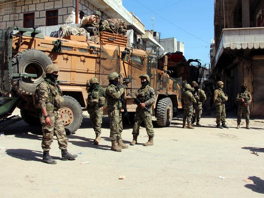 Turkish soldiers, positioned in the city center of