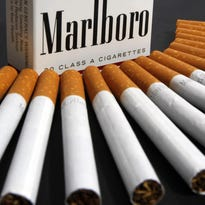 FILE - In this July 17, 2012, file photo, Marlboro cigarettes are displayed in Montpelier, Vt. Cigarette maker Philip Morris International Inc. reports financial earnings on Thursday, Feb. 4, 2016. (AP Photo/Toby Talbot, File)