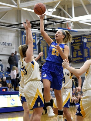 Mariemont's Ashley Rothert finds a way through the paint to the hoop for the Lady Warriors, Jan. 20, 2018.