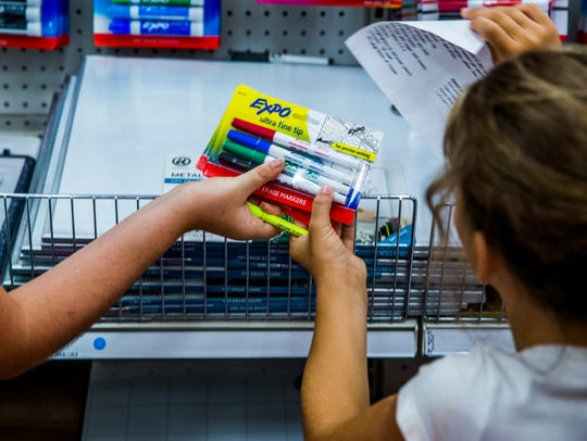 Children shop for school supplies at Target in North