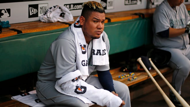 Seattle Mariners starting pitcher Felix Hernandez sits in the dugout during the first inning of a baseball game against the Pittsburgh Pirates in Pittsburgh, Tuesday, July 26, 2016. The Mariners won 7-4.