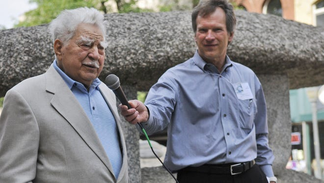 """Mike Helgeson, right,  holds the microphone for sculptor Anthony Caponi as he speaks about the """"Granite Trio"""" on Friday morning on St. Germain Street during a 2013 ceremony marking the sculpture's 40th anniversary. Caponi died last week at the age of 94."""