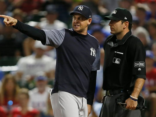 New York Yankees manager Aaron Boone (17) argues with home plate umpire Pat Hoberg (31) after being ejected in the game against the Texas Rangers at Globe Life Park in Arlington.