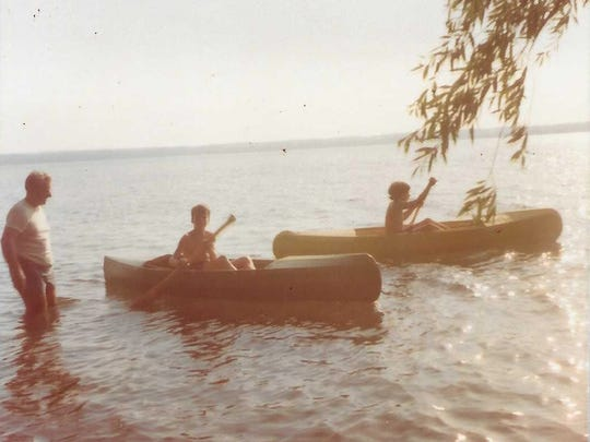 Matt Bianconi in a canvas kayak built by his father,