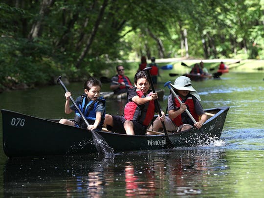 Brothers Fernando, Ovaldo and Jose Garcia of Wharton take a turn in the canal at the Morris Canal Day Festival Saturday.
