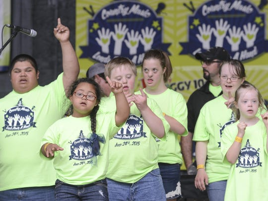Kids performed during the Country Music Lends Down a Hand concert benefitting the Down Syndrome Association of West Tennessee Wednesday at the outdoor amphitheater at Casey Jones Village.