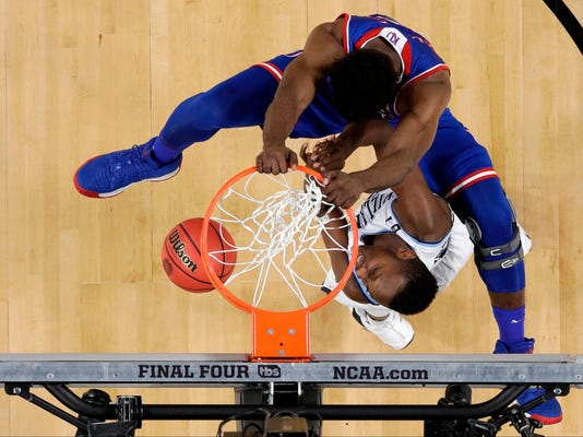 Kansas's Udoka Azubuike, top, dunks over Villanova's Dhamir Cosby-Roundtree during the first half in the semifinals of the Final Four NCAA college basketball tournament, Saturday, March 31, 2018, in San Antonio. (AP Photo/David J. Phillip)