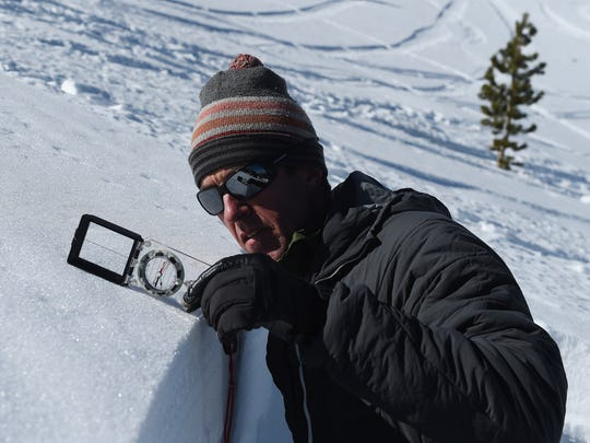Owner of the Tahoe Mountain School and official observer for the Sierra Avalanche Center Steve Reynaud checks the exact degree of a northeast slope on Mount Tamarack near the top of Mt. Rose Highway south of Reno on Feb. 24, 2015.