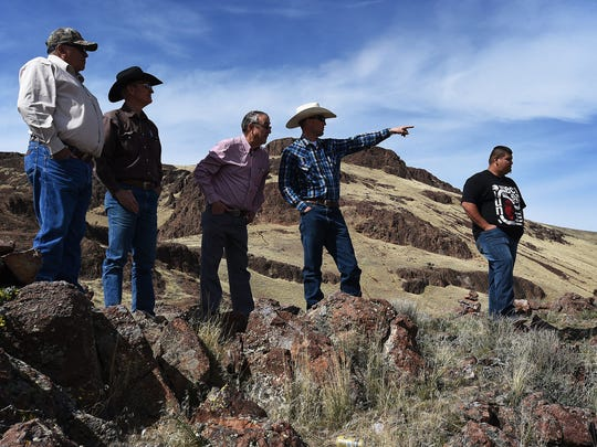 Rancher Shane Hall, middle, points out domestic tribal horses grazing illegally in the Santa Rosa Mountains near the Fort McDermitt Paiute Shoshone Reservation in Northern Nevada on March 30, 2015. Hall is standing with, from left, Gerry Emm, Shane's father Steve Hall, Gary Bengochea, and Tildon Smart, Chairman of the Fort McDermitt Paiute Shoshone Tribe.