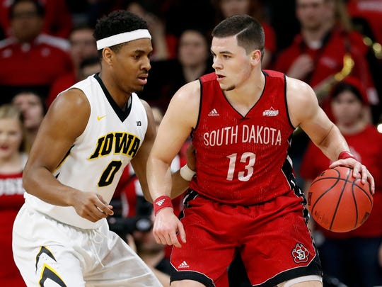 South Dakota guard Matt Mooney (13) drives around Iowa
