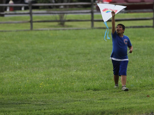 Sam Beutel, 11, of Clarkstown, NY, gets ready to fly a kite at Historic New Bridge Landing in River Edge.  Sunday, July 22, 2018