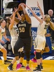 Warren Central High School junior center Cydni Dodd (50) against Zionsville defenders in the Class 4A title game.