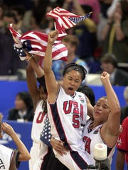 Dawn Staley and Nikki McCray celebrate Team USA's gold medal in the 2000 Olympic Games.