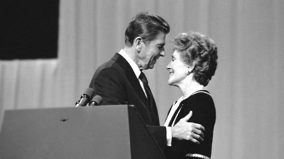 Ronald Reagan embraces his wife, Nancy Reagan, after