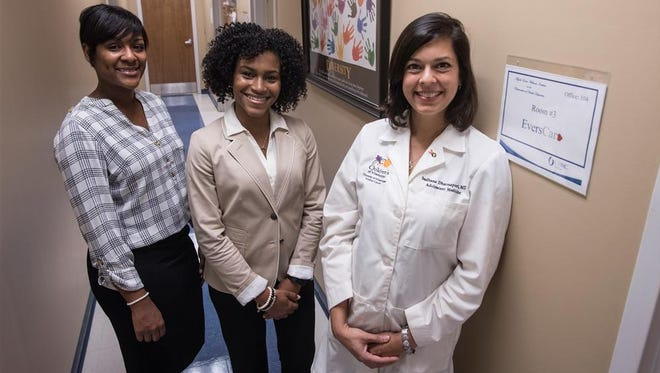 Elizabeth Bell, left, and Jana Bailey are coordinating the new EversCare program as a partnership with the Division of Adolescent Medicine. Dr. Sadhana Dharmapuri, right, is division chief.