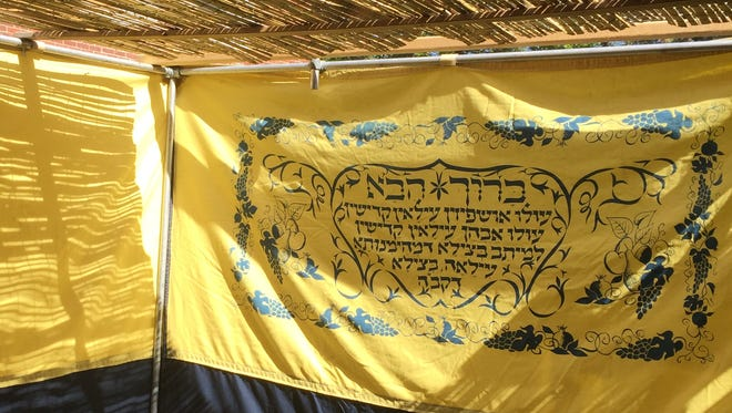 This is a partial inside view of the sukkah at Kessler Family Chabad Center for Jewish Life on Winton Road.