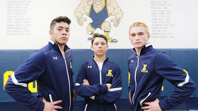 Noah Vasquez, left, Isaiah Delgado, center, and Ryan Chavez are standouts for the Eastwood wrestling team.
