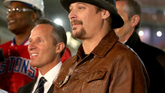Kid Rock poses for a group picture with other dignitaries and construction workers after a press conference was held inside the Little Caesars Arena in Detroit on Thursday, January 19, 2017 where Kid Rock was announced as the opening act of the new arena in September.