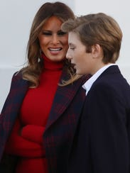 First lady Melania Trump and her son Barron welcome