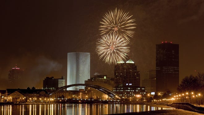 Rochester's New Year's Eve fireworks display over downtown, seen from the trail along the river, under the Ford Street Bridge, south of the city, on Dec. 31, 2009.