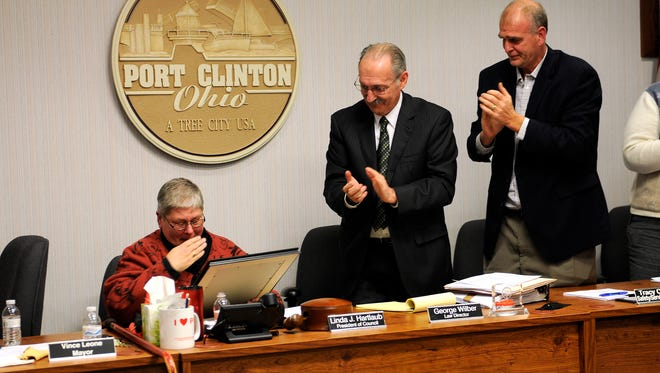 Members of Port Clinton City Council and administration applaud Linda Hartlaub, former council president, during her final meeting in December 2015.