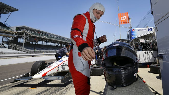 IndyCar driver Gabby Chaves gets ready to climbs into his car during practice for the 100th running of the Indianapolis 500 Thursday May 19, 2016, afternoon at the Indianapolis Motor Speedway.