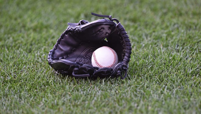 A general view of a baseball and glove.