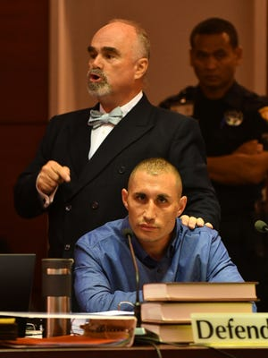 Attorney Curtis Van de veld points to his client Allan Aloan Agababa and tells jurors he is innocent unless proven otherwise in court while delivering opening statements in Agababa's murder trial on Sept. 11, 2017. Following a mistrial in 2014, Agababa is on trial for the second time in the 2013 death of his mother, Shelly Bernstein.