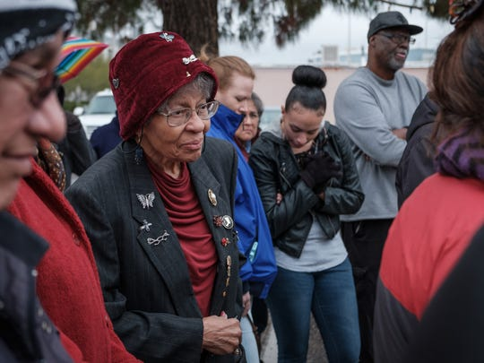 Dorris T. Hamilton, retired educator and civil rights activist, listens to a blessing given before the Martin Luther King Day march in downtown Las Cruces on Sunday. A group of locals, including members of the NAACP, gathered to commemorate Martin Luther King Jr.'s life and deeds.