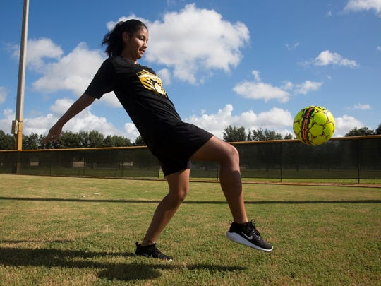 Maria Rodriguez dribbles a soccer ball at Immokalee Community Park on July 6, 2017. Rodriguez is not eligible for federal financial aid because she is a Deferred Action for Childhood Arrivals (DACA) recipient, so the community raised money to help her pay for school. She will be attending Broward College and will play soccer.