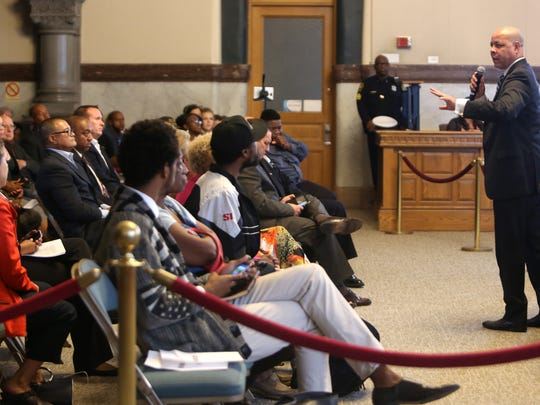 Cincinnati City Manager Harry Black addresses the crowd during a Cincinnati City Council meeting addressing Police Chief Jeffrey Blackwell being fired.