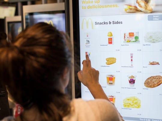 McDonald's customer orders at a freestanding kiosk.