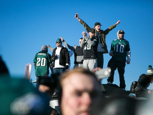 Fans cheer as the Eagles team return from their Super Bowl LII win as they arrive at the Philadelphia International Airport.