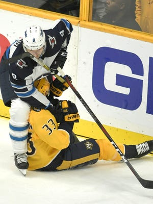 Predators left wing Viktor Arvidsson (33) and Jets defenseman Jacob Trouba (8) get tangled up during the first period in Game 2 of the second round NHL Stanley Cup Playoffs at the Bridgestone Arena Monday, April 30, 2018, in Nashville, Tenn.