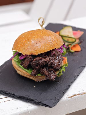 The ox tail slider with pickles from Chef Danielle Leoni of Breadfruit Jamaican Grill as seen in Phoenix on Jan. 14, 2015.