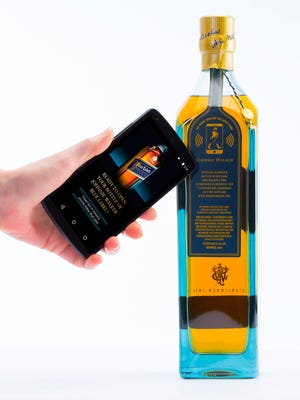 """The Johnnie Walker Blue Label """"smart bottle"""" will make it possible to send consumers targeted and timely marketing messages, whether at retail or after purchase, such as promotional offers, cocktail recipes and exclusive content. [Via MerlinFTP Drop]"""
