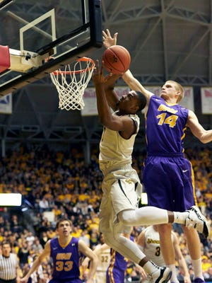 Wichita State Shockers forward Shaquille Morris (24) shoots over Northern Iowa's Nate Buss on Saturday. Wichita State beat Northern Iowa 74-60 to claim the Missouri Valley Conference's regular-season title.