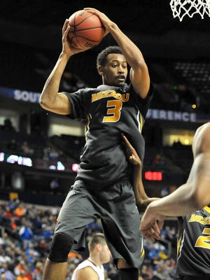Missouri Tigers forward Johnathan Williams III (3) gets the rebound against South Carolina Gamecocks during the second half of the first round the SEC Conference Tournament at Bridgestone Arena.