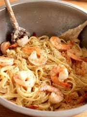 Pepper-scampi Alfredo is cooked with shrimp, or chopped, cooked chicken breasts, crispy hunks of bacon or strips of smoked salmon can be substituted for the shrimp.