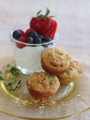 Lime and avacado streusel mini muffins are served with fruit and yogurt.