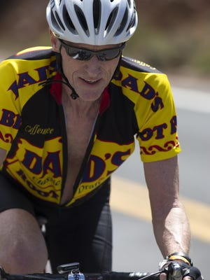 Bicyclists like Court Phillips of Tempe can log their daily mileage in the National Bike Challenge to win prizes and bragging rights.